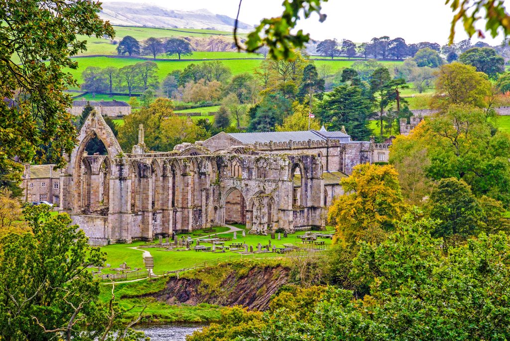 Bolton Abbey seen through the trees from across the River Wharfe