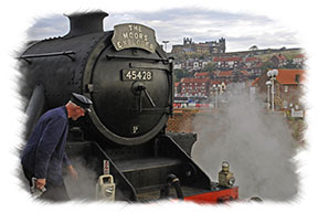 North Yorkshire Moors Railway - Steam engine and Whitby Abbey