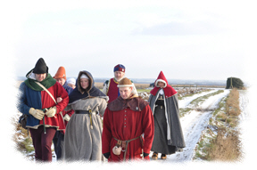 Picture of folk in medieval costume walking across the battlefield of Towton. Click the picture to read about the Battle of Towton
